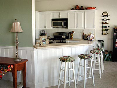 The Wainscoting From The Living Room Follows Through To The Kitchen Counter  Seating Area.